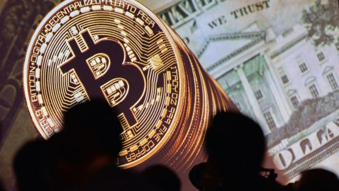 比特幣價格快速跌破8000美元 來到1個月低點(圖片:AFP)