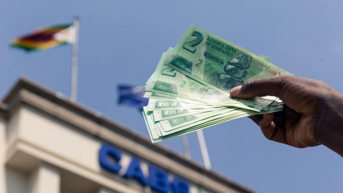 辛巴威貨幣血淚史(圖片:AFP)