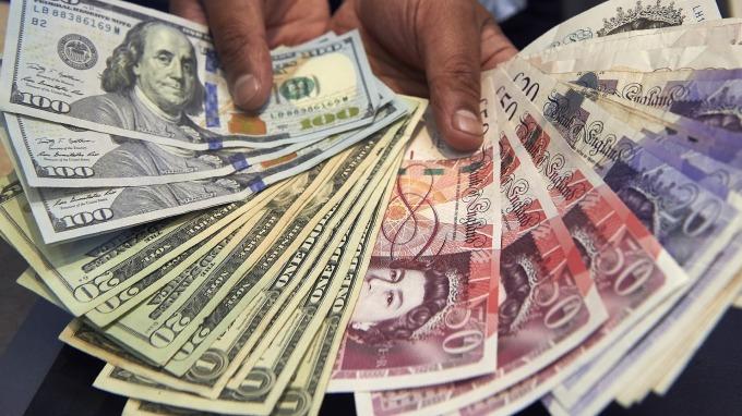 紐約匯市—貿易談判未有進展 美元持平 歐元區經濟有望復甦 英鎊走軟日圓續飆(圖片:AFP)