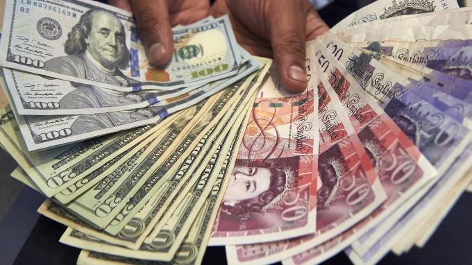 美國經濟數據優於預期 美元上揚 日圓走貶 保守黨穩守支持率 英鎊走高(圖片:AFP)