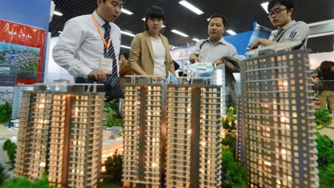 中國百城11月房價月增率略增 保持相對低檔(圖片:AFP)