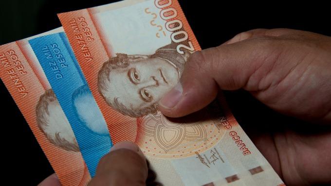 一輪大跌後 拉美貨幣有望12月回彈? (圖片:AFP)