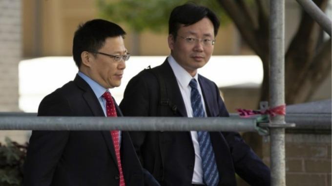 中方財政部副部長廖岷(左)。(圖片:AFP)