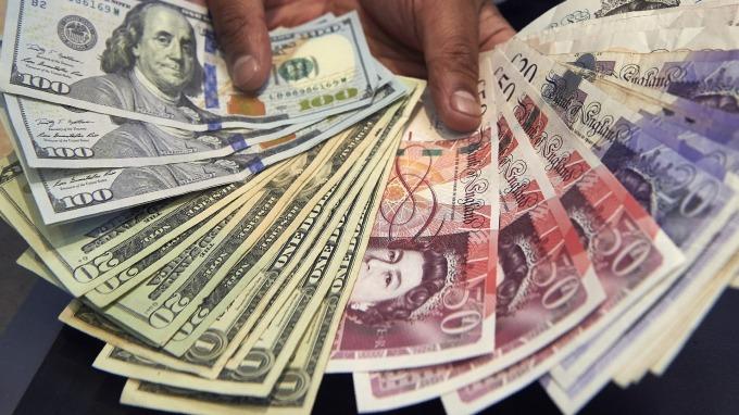 紐約匯市—15日新關稅取消 美元下滑 英國保守黨獲壓倒性勝利 英鎊飆升(圖片:AFP)