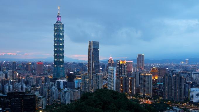 北市12行政區公告土地現值全上漲,台北101七度蟬聯地王。(圖:AFP)
