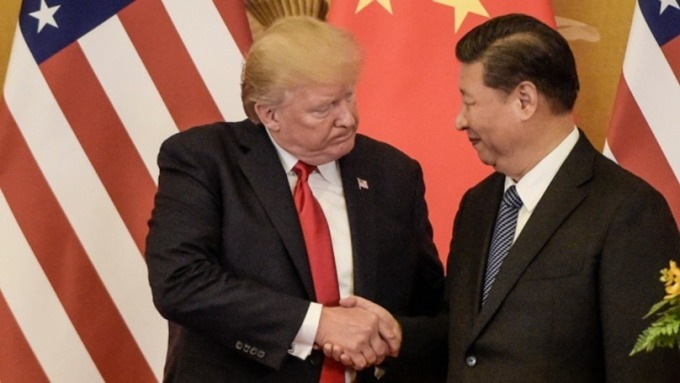 川普:已與習近平通話!雙方正安排正式簽署貿易協議 (圖片:AFP)
