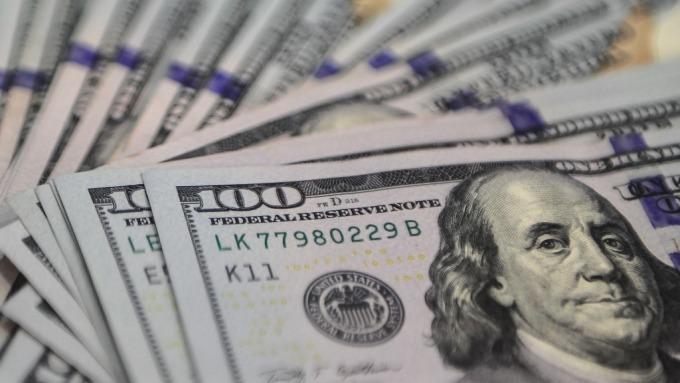聯準會資產負債表與美元的關係,關鍵在企業海外資金的流向。(圖:AFP)