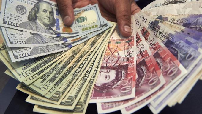 紐約匯市—初階貿協有望於下週簽署 美元續跌 英鎊收復失地 回升至1.31(圖片:AFP)