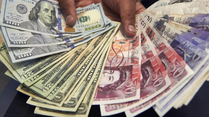紐約匯市—中東情勢升溫 美元漲勢承壓 避險日圓走揚至兩個月新高 英鎊續跌(圖片:AFP)