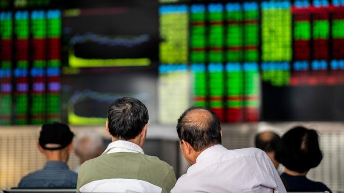 生技股抬頭,大盤低頭。(圖:AFP)