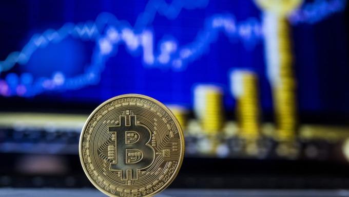 美伊亂局中比特幣重拾升勢 上漲突破8400美元(圖:AFP)