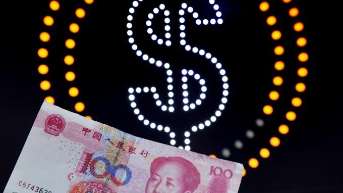 今人民幣中間價報升近150基點 人民幣近40天升值1000基點(圖片:AFP)
