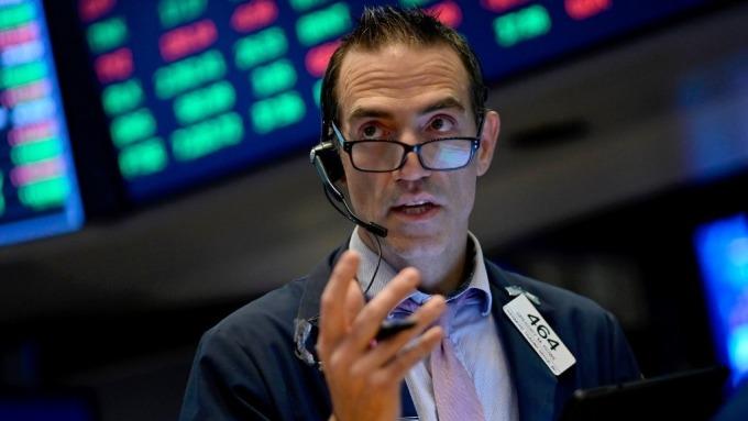 為何就業報告「令人失望」卻可能有利美股走高?(圖:AFP)
