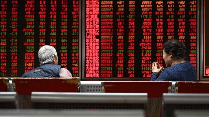 美中貿易戰和緩,外資認為中國今年GDP仍可保6。(圖:AFP)