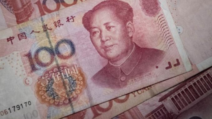 人民幣直逼6.87關卡 六產業受惠(圖片:AFP)