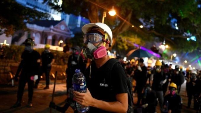 越來越多香港基金公司申請「落地」新加坡 (圖片:AFP)