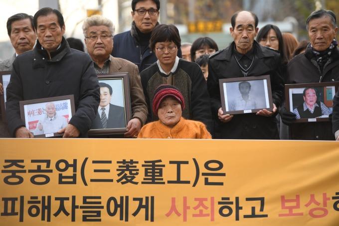 日韓因二戰徵用工問題摩擦不斷 (圖片:AFP)