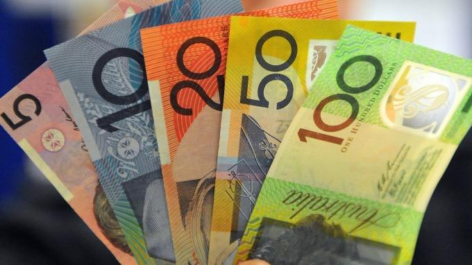 澳幣因貿易戰走貶 卻可能因美中協議簽署變得更弱 (圖:AFP)