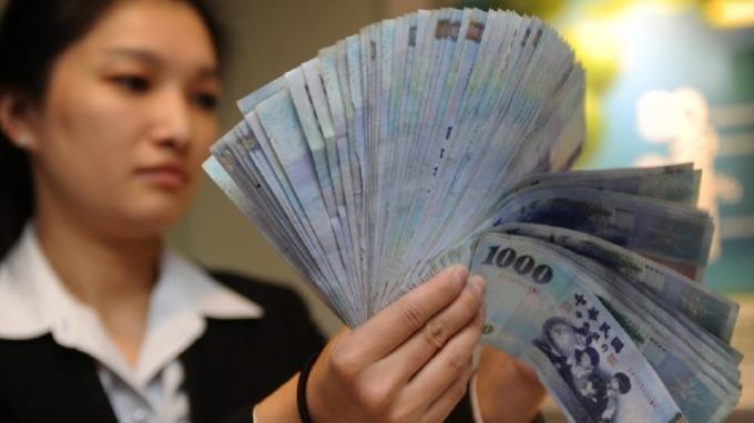 台灣境內基金規模破4兆,再創歷史新高。(圖:AFP)