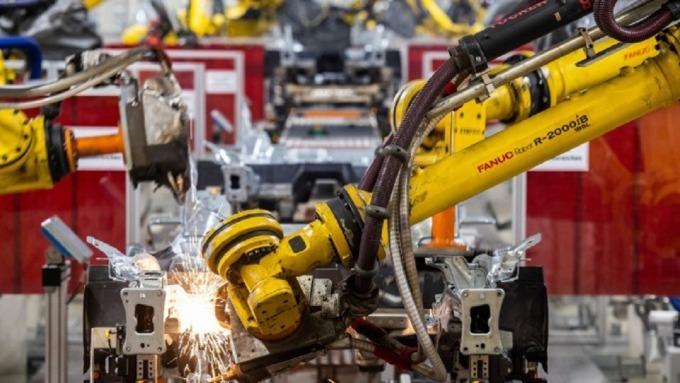 工業4.0將繼續推動工業機器人、新自動化物流的需求。(圖:AFP)