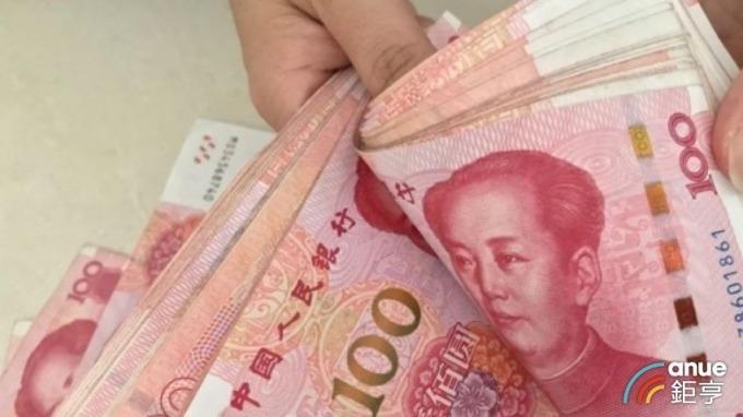 美中貿易摩擦局勢和緩,瑞銀認為人民幣匯率可望回升至6.7元。(圖:AFP)