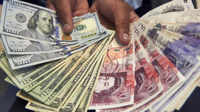 景氣漸復甦 美元續漲 英國降息呼聲高 英鎊歐元走軟(圖片:AFP)