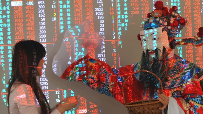【鍾國忠專欄】台股迎接新春開金鼠紅盤。(圖:AFP)