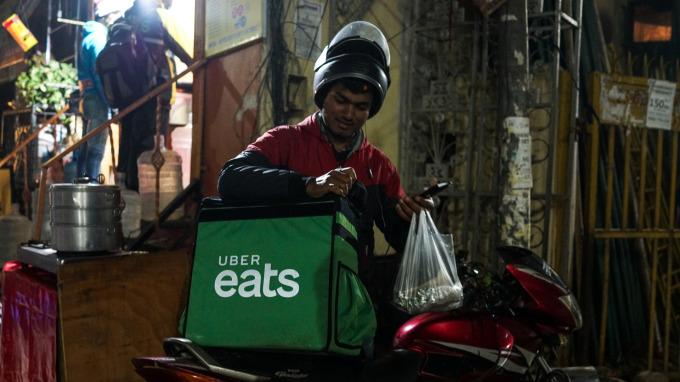 削減虧損事業 Uber出售Uber Eats給印度競爭對手(圖片:AFP)