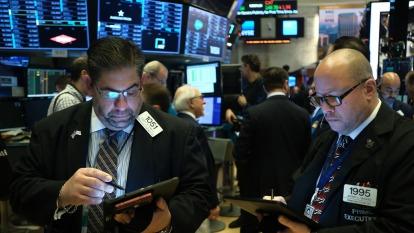 〈美股盤後〉武漢封城!IBM春風拂面 特斯拉市值突破千億美元。(圖片:AFP)