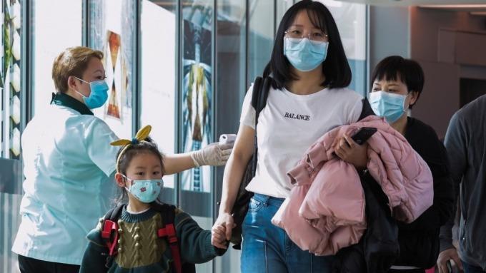 武漢肺炎新增688例 死亡累計56人 旅行社全數暫停出團(圖片:AFP)