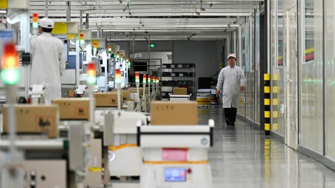 武漢肺炎期間不停工!華為、中芯等科技大廠照常營運 (圖:AFP)