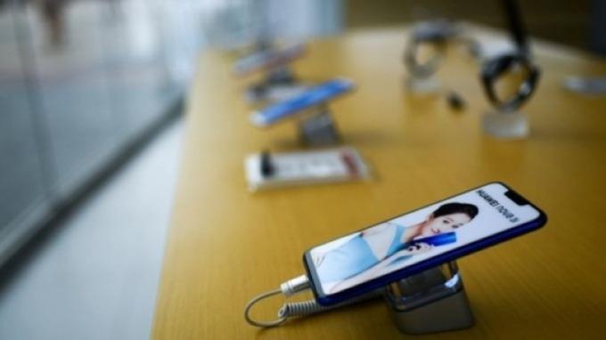 中國祭封城、封閉式管理後 華爾街紛下修Q1中國手機出貨量 (圖片:AFP)