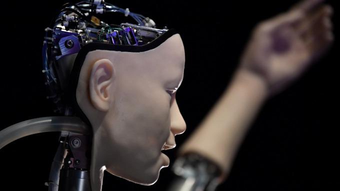 肺炎疫情加速機器人需求 (圖片:AFP)