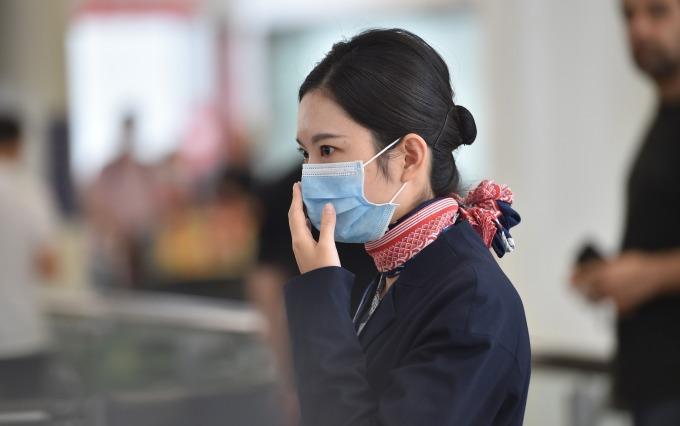武漢入境南韓的追蹤調查結束 智庫發表景氣看法 (圖片:AFP)