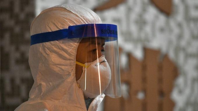 新冠肺炎死亡人數破千 WHO:15%轉肺炎、3-5%重症 漢堡王關閉半數分店(圖片:AFP)