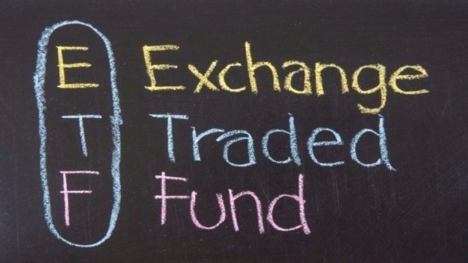 市場震盪加劇 升息風險消彌有利債市 這類ETF可為資金避風港。(圖:AFP)