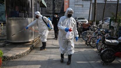 武漢疫情在中國境內全面擴散,衝擊全球經貿及消費動能。(圖:AFP)
