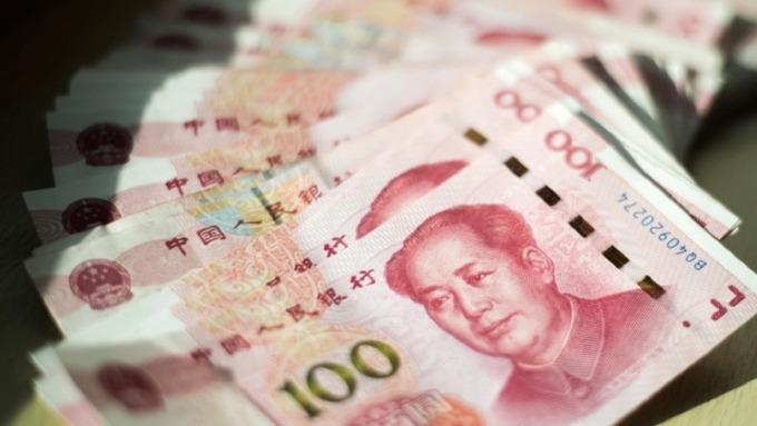 疫情隔離 中國債匯市交易量暴降 (圖:AFP)