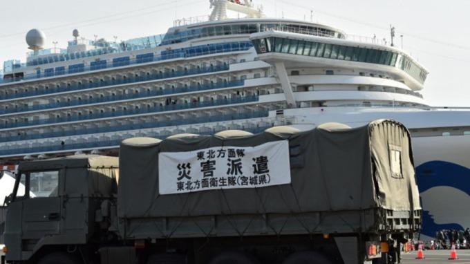 日本旅遊疫情警示升級 外交部:已表明欲接回鑽石公主台人。(圖:AFP)