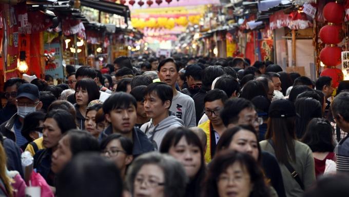 因應武漢肺炎疫情,北市將祭融資紓困方案,設單一窗口協助產業。(圖:AFP)