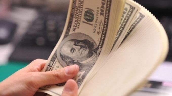 因應新冠狀病毒, 回防強勢美國美元投資級債,兼顧收益機會與防禦。(圖:AFP)