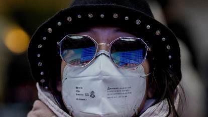 牛津經濟:武漢肺炎若擴散全球 經濟恐蒸發1.1兆美元(圖片:AFP)