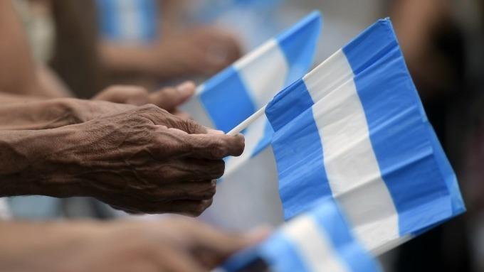 IMF警告:阿根廷債務水準「不可持續」 私人債權人恐需承擔損失 (圖:AFP)
