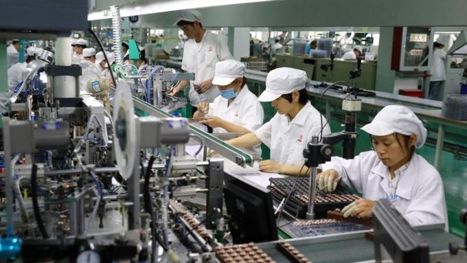中小企業方案再添3家建智慧化產線,累計投資金額達617億元。(圖:AFP)