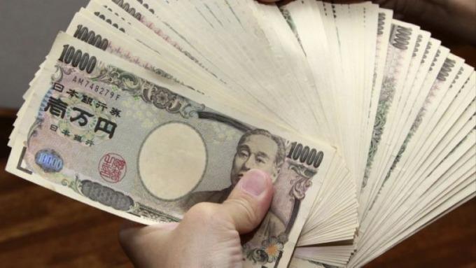 武漢疫情衝擊日本經濟 日圓由避險資產轉為負債(圖:AFP)