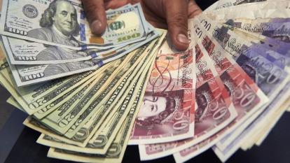 〈紐約匯市〉市場降息呼聲高 美元走軟 英鎊強漲 日圓連漲三日(圖片:AFP)