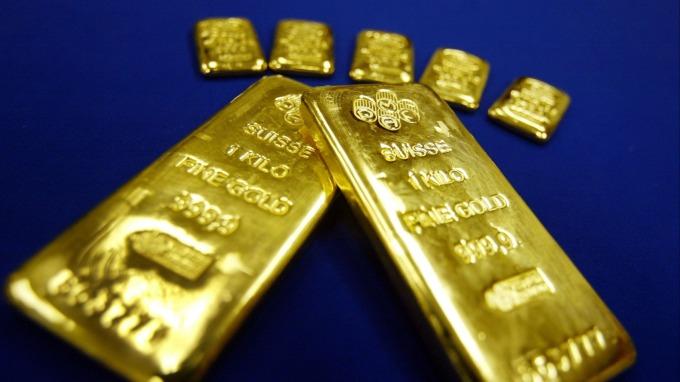 〈貴金屬盤後〉市場獲利了結 黃金大回檔 (圖片:AFP)