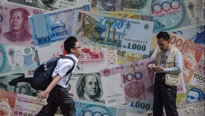 疫情重擊亞洲銀行業,專家估營收蒸發數十億美元。(圖:AFP)