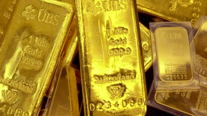 〈貴金屬盤後〉憂疫情全球大流行 黃金避險需求回彈 鈀金破紀錄(圖片:AFP)