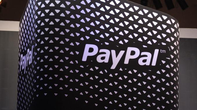 又一跨境電商慘遭疫情毒手  PayPal示警Q1營收恐跌1%(圖片:AFP)